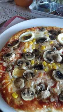 a close up of a plate of food with a slice of pizza